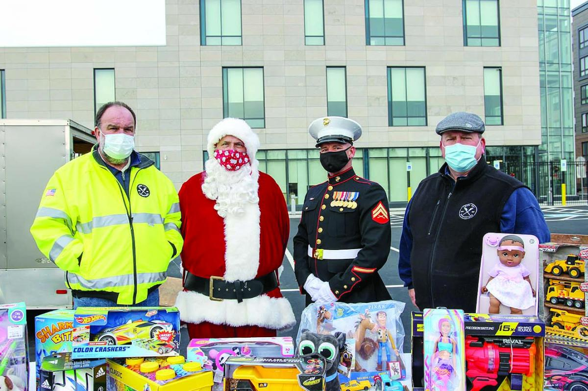 Local 537 Business Manager Tom Kerr, Santa Claus, Marine vet and Inside Guard Danny O'Brien, and Organizer Chris Brennan with toy donations.[2][1].jpg