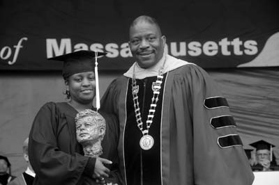 Dominique Powell received the John F. Kennedy Award from UMass-Boston Chancellor Dr. J. Keith Motley