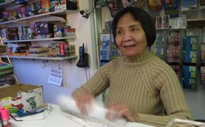 Anh Vo: Assists customers at Maria's Market on Dorchester Ave., one of many convenience stores with a high volume of SNAP purchases. Photo by Steve Kurkjian