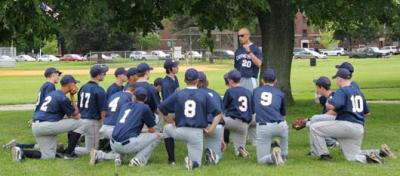 Champs seek to repeat: Boston Collegiate Charter School baseball coach Matt Underhill gives the Hurricanes a pep talk before the Charter School State Championship semi-finals on Monday at Joe Moakley Park.  Photo by Elizabeth Murray