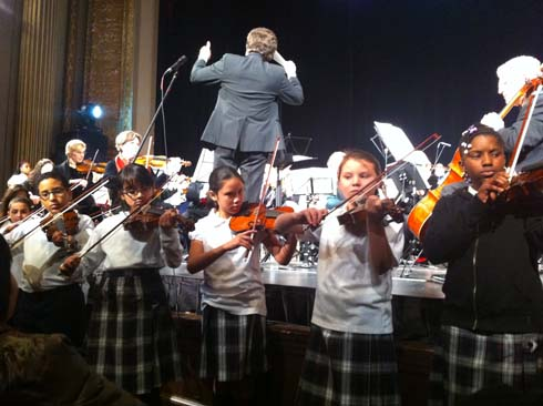 Dorchester Christmas Celebration: Steve Lipsitt and the Boston Classical Orchestra with the Pope John Paul II Catholic Academy strings ensemble. Photo by Bill Forry