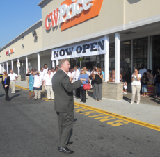 CW Price: Above, Sen. Jack Hart welcomed the retailer to Dorchester on Thursday morning. Photo by Ed Forry
