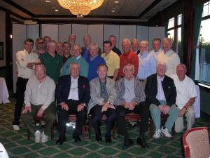 Club 13 alumni smile for the camera at their reunion last Friday.