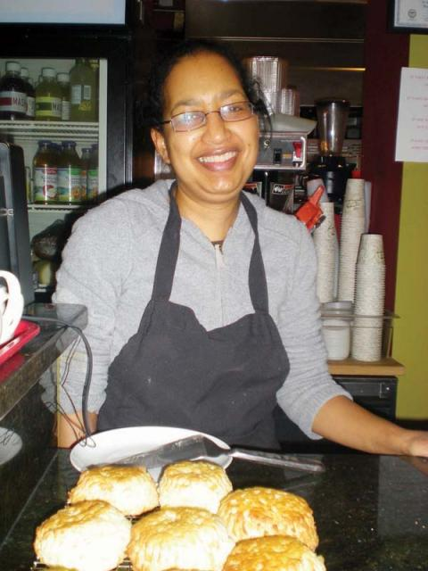 Dot2Dot: Karen Henry Garrett with some of her homemade bread at Dot2Dot Cafe. 	   Photo by Sue Asci