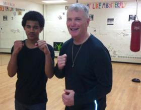 St. Peter's Boxing duo: Boxing coach and former DEA agent Paul Doyle, right, with 15 year-old Jose Pires. Photo by Eoin Cannon