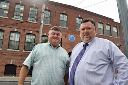 Greg and Brendan Feeney: Entrepreneurs have built a thiving utility excavation business from their base in Dorchester. Above, the brothers are shown outside their newly renovated headquarters on Clayton Street. Photo by Bill Forry