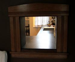 A pass-through nook connects the kitchen and dining room