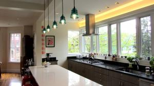Their open kitchen's light fixtures include one found glass cover and several impeccable replicas.