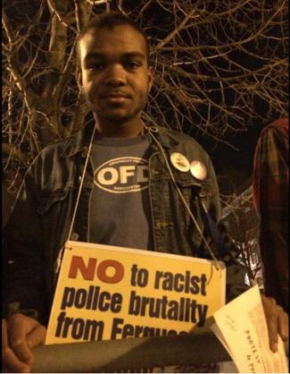 Protestor in Dudley Square: Isaiah Wilkerson, 19, is from Fields Corner and joined a protest march from Dudley Square to South Bay last night. Photo by Lauren Dezenski