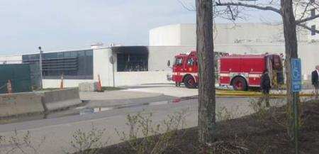 Probe continues into Monday fire: Another view of the damage to the JFK Library. Photo by Bill Forry