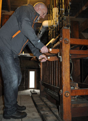 Jeff Gonyeau plays the bell chime in All Saints Church: Photo by Bill Forry
