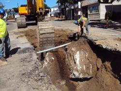 Lower Mills MWRA project: Workers unearthed a huge piece of ledge on Washington Street during the pipe replacement job last year. File photo