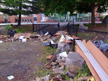 Lee School dumping: The scene last week after someone dumped trash outside the Lee School, which had just been cleaned by volunteers.