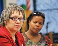 School assignment reform hearing at English High: Dr. Lisa Gonsalves, associate professor of curriculum and instruction at the College of Education and Human Development at UMass Boston, spoke Monday as Kim Janey, of Massachusetts Advocates for Children, looked on. Eric Esteves photo
