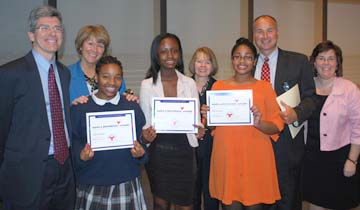 Pope John Paul II Catholic Academy students honored for service: (l-r):Library Director Tom Putnam, Columbia Campus Principal Claire Sheridan, Johanna Thermitus, Richelene Pierre, Lower Mills Principal Kim Mahoney, McKenzie Jeanette, Academy Regional Director Russ Wilson, Neponset Campus Principal Kate Brandley.