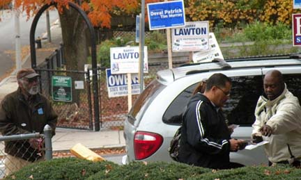 Election 2010: Cardinal Medeiros Manor in Ward 13: At right, a volunteer for write-in candidate Barry Lawton talked to a voter as Carlos Henriquez's father Julio looked on at left.