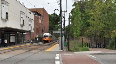 Neponset Greenway: The Mattapan trolley stop at Central Ave, left. A proposed Greenway path would follow a route closer to the river, at right.  Photo by Ed Forry