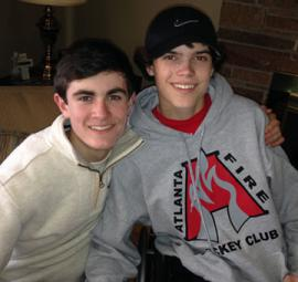 Best friends: Joey O'Leary and Mark Delamere are organizing a street hockey tournament to help Kevin Cellucci. All three were injured in a horrendous car crash on the Arborway last September. Photo courtesy Sheila Delamere