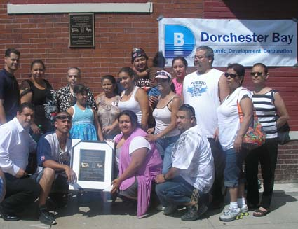 Serrano ceremony: Family of Geraldo Serrano gather around a plaque in his honor last Saturday.