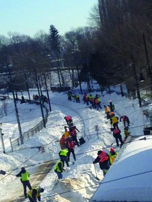 Mattapan Line: Workers labored to clear the Mattapan trolley tracks near Milton station over the weekend. Service resumed on the trolley line on Monday after weeks of being off-line due to snow and ice. Photo courtesy Ellen Berlin