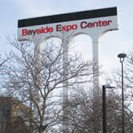 Bayside Expo Center: This obsolete sign straddles property owned by Corcoran Jennison and UMass Boston. It's removal has become part of the stalemate on the site.