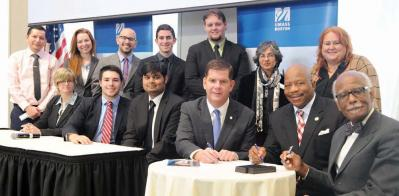 Mayor Walsh and UMass Boston Chancellor Keith Motley signed an agreement last Friday that will continue the university's new Mayor's Policy Symposium into future years. That same day, the inaugural class briefed the mayor on its ideas for revitalizing the Strand Theatre. 	Harry Brett/UMB photo