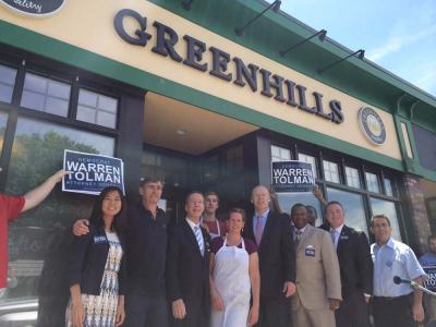 Cindy and Dermot Quinn, owners of Greenhills Bakery, pose with Dorchester elected officials Michelle Wu, Stephen Lynch, Warren Tolman, Steven Tompkins, Daniel Cullinane, and Frank Baker outside the bakery early Monday afternoon. 	Photo by Lauren Dezenski
