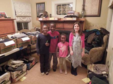 Dot steps up to aid fire victims  : Neighbors have rallied to help out 14 people displaced by a fast-moving fire that destroyed their home at 49 Mather St. on Feb. 10. Above, (l-r) youngsters Mateo, Diego, and Nia Benzan Buyu and Ella Moye-Gibbons are shown with boxes of clothing and supplies that were dropped off to the Moye-Gibbons home. A fund launched through the Dorchester House has generated nearly $4,000 to assist the survivors of the blaze. Photo courtesy Jenny Moye