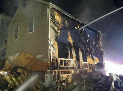 Twelve people were injured when a gas leak explosion destroyed this home at 27 Hansborough Street in April 2014. 	Photo courtesy Boston Fire Dept.
