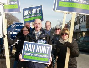 Dan Hunt: Dan Hunt, above holding sign is pictured with supporters during a standout in Adams Corner last weekend. The 33 year-old attorney was the first candidate to announce plans to run for the 13th Suffolk seat.