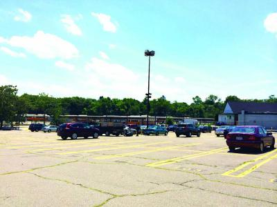 MBTA Lot: Roughly two dozen vehicles were parked in the T's Mattapan lot early Monday afternoon. 	Lauren Dezenski photo