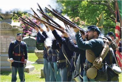 Memorial Day 2014: Members of the Irish 28th MA Volunteers fired their weapons during a salute at last year's Memorial Day observances in Cedar Grove Cemetery. Chris Lovett photo