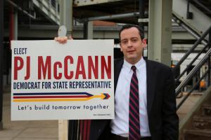 McCann: PJ McCann greeted voters at the JFK-UMass MBTA station this week.            	             Photo by Mike Deehan
