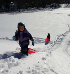 Walsh Park Coasting: Sprung from school, Madeleine (9) and Clare (6) Ablett enjoyed the thrill ride on the slopes of Clancy Road. Photo courtesy Ann Walsh