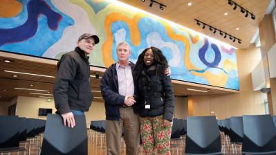 Clarita Stephens shaking hands with City of Boston Property and Construction Management Department senior project manager, Tom Leahy (OFD); James Hobin, at left.  Mark Millstein photo