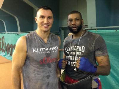 Heavyweight boxing champion Wladimir Klitschko, left, is shown with Dorchester's Donnie Palmer this week at the champ's training camp in the Austrian Alps. 	Photo courtesy Donnie Palmer