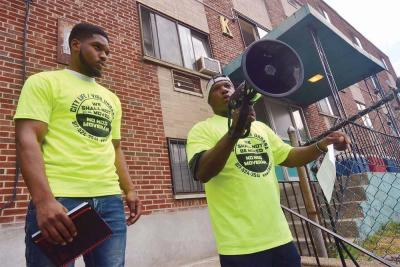 Steven Julien-Stewart, left, and Anthony Dabney, right, who lives in an apartment at 200 Hancock St. with his 11 year-old son, spoke out at a rally last Saturday. Tenants are upset that the owner has raised rents without making improvements to the building, which they claim is in poor condition. Chris Lovett photo