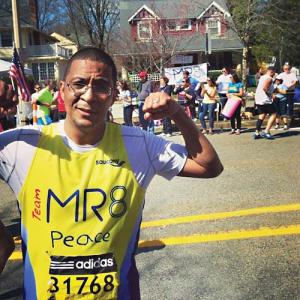 "Team MR8 member Harry Benzan, Martin Richard's soccer coach, did 27 push-ups when he finished the race, despite the pain and dehydration. ""It was one of the greatest honors in my life."" Photo courtesy Harry Benzan"