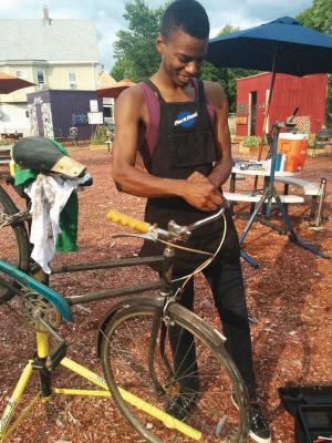 Noah Hicks, 28, worked on a bike at his Bowdoin Street repair shop.