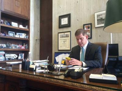 Mayor Martin Walsh sits at his desk at City Hall after speaking to the Reporter on Tuesday afternoon. Lauren Dezenski photo