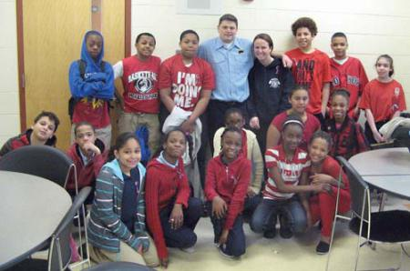 Mildred Ave. kids: Firefighter Jim Walsh joined students from the Mildred Avenue School on Monday. Shown, (standing, l-r) are Yanell Woods, Camari Bailey, Jaquan Jones, Firefighter Jim Walsh, teacher Lynne Travers, Jamoni Waller, Narzvel Sawyer Rodriguez and Evy Ayala; (sitting, l-r) Ibsael Polanco, Danny Silvestre, Simone Darling, Chiosna Bernadeau, Tyra Jennings,Kendra Cole, Destiny Omo, Princess Sawyer Rodriguez, Keren Osorio and Tamera Francois.