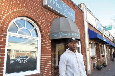 "Tambo Barrow hopes to be a ""burger innovator"" in Lower Mills. 	Photo by Bill Forry"
