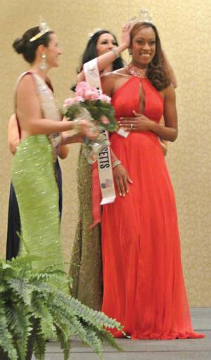 There she is:: Dorchester's Janelle Woods-McNish, right, was crowned Mrs. Massachusetts during a pageant on March 19 at the Boston Marriott-Newton. Photo courtesy Mrs. Massachusetts