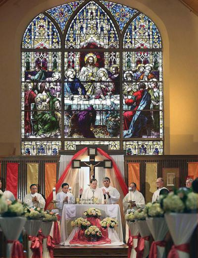 St. Ambrose parish in Fields Corner marked its centennial on Sunday with a Mass and luncheon. . 	Bill Brett photo