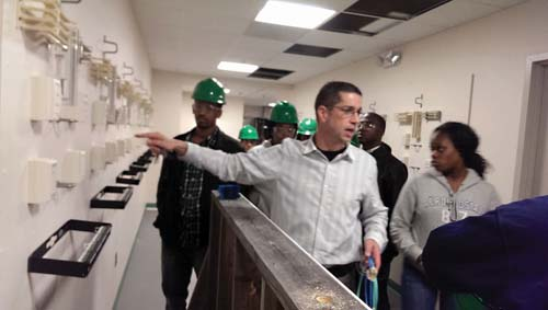 Building Pathways: Students learn about fiber optics at IBEW Local 103. Photo by Gintautas Dumcius