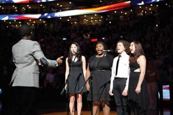 Left to right: Robert Gould, Adeline Um, Lea Grace  Hicks-Swinson, Calvin Falcon, and Grace Mann perform the national anthem at TD  Bank Garden. Photo by Kelly Davidson
