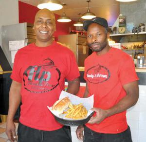 Hardy & Person Catering: Jonathan Hardy and Kari Person are the operators of a new restaurant at 787 Adams Street that specializes in gourmet hot dogs and soul food. Photo by Bill Forry