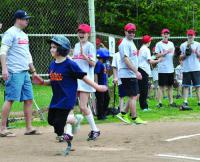 Jane Richard, 8, crosses the plate on Xavier Bell's hit, posting a run for the Savin Hill Astros. Photo by Bill Forry