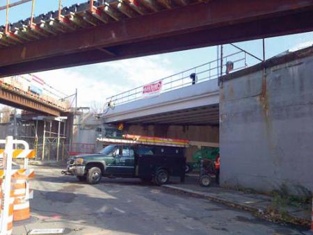 Clayton St. bridge: After months of preparation, workers swung a new bridge into place above Clayton Street over the Veterans Day weekend. The new span, pictured above, carries Red Line trains above the street en route to and from Fields Corner station. 	Photo courtesy MBTA