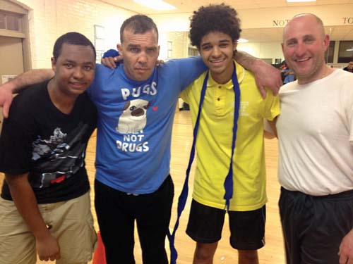 St. Peter's Boxing duo: Alvaro Monteiro, 16, former professional boxer Joey DeGrandis, Jucilino Barros, 17, and Stephen Doran, Boston Police Department Safe Street Team. Photo by Eoin Cannon